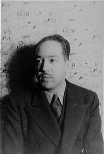 Langston Hughes photographed by Carl Van Vechten, 1936. From the collection of the Library of Congress and in the public domain. Image copied from Wikimedia commons (©Wikimedia)
